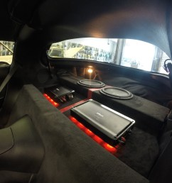 custom led lighting underneath amps custom amp rack and sub enclosure wrapped in suede and red trim stripe  [ 1500 x 1125 Pixel ]