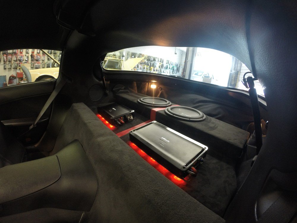 medium resolution of custom led lighting underneath amps custom amp rack and sub enclosure wrapped in suede and red trim stripe