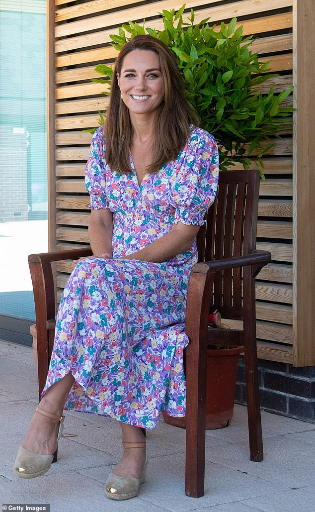 The Duchess, 38, poses for a photo outside the hospice on June 25, wring a new pair of $242 Russell and Bromley espadrilles