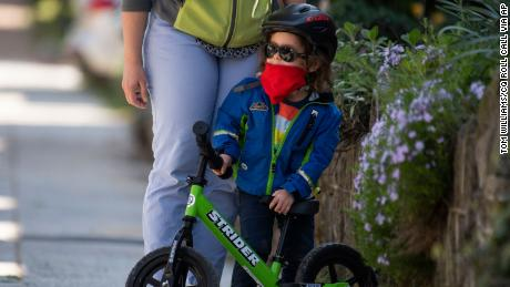 A 3-year-old wraps up a bike ride on Randolph Place NW, in the Bloomingdale neighborhood during the coronavirus outbreak on Monday, April 6, 2020.