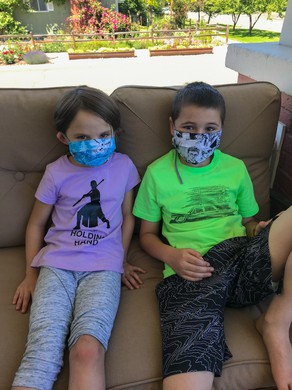Maggie Anderson, 6, and Orrin Anderson, 6, with their themed masks. Summer programming in the Baker School District will be in-person, and masks are encouraged.