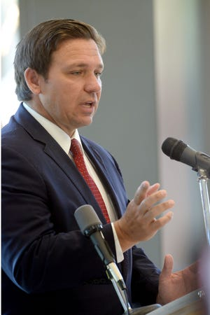 Gov. Ron DeSantis announces a $2.8 million grant for a new diesel mechanic training program at Northwest Florida State College during a press conference Thursday in Niceville.