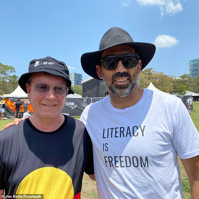 A sacked senior public servant has sent a lengthy 486-word email to staff after being replaced with Michael Coutts-Trotter (pictured is Jim Betts with footballer Adam Goodes)