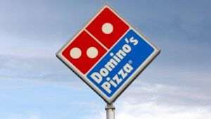 A tall Domino's Pizza (DPZ) sign stands in Eau Claire, Wisconsin.
