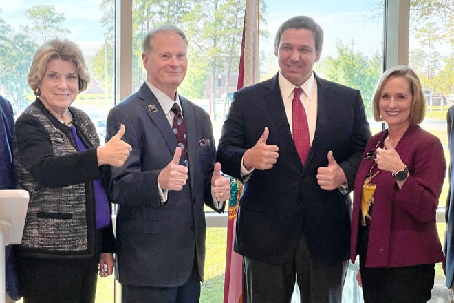 Gov. Ron DeSantis (second from right) poses with Northwest Florida State College President Devin Stephenson and other members of the college's board of trustees after an announcement Thursday that the college will receive a $2.8 million grant for a new diesel mechanic training program.