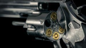 A 3D render of a Smith & Wesson Model 625 revolver with bullets in several of the chambers.