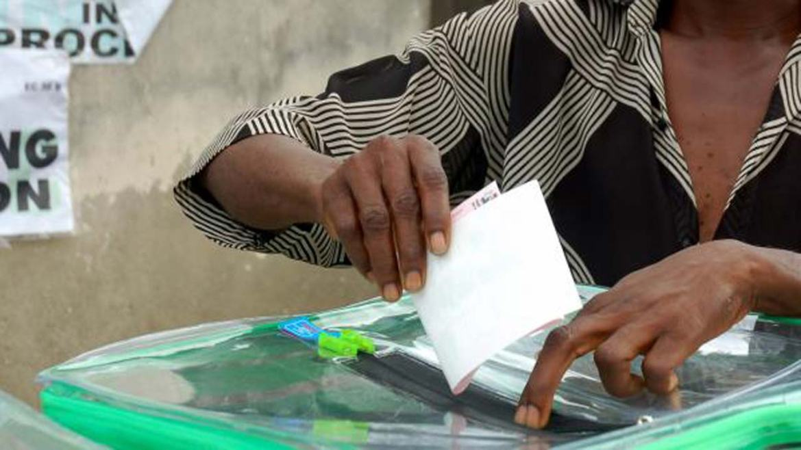 Image result for pics of hands in ballot box in Nigeria