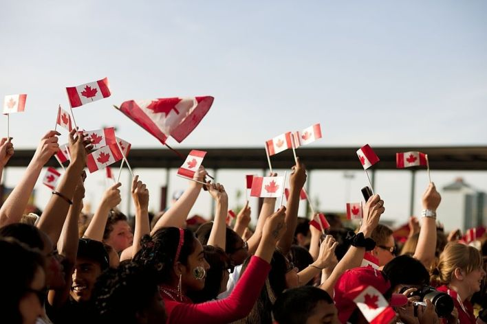 Canadians Waving Flags
