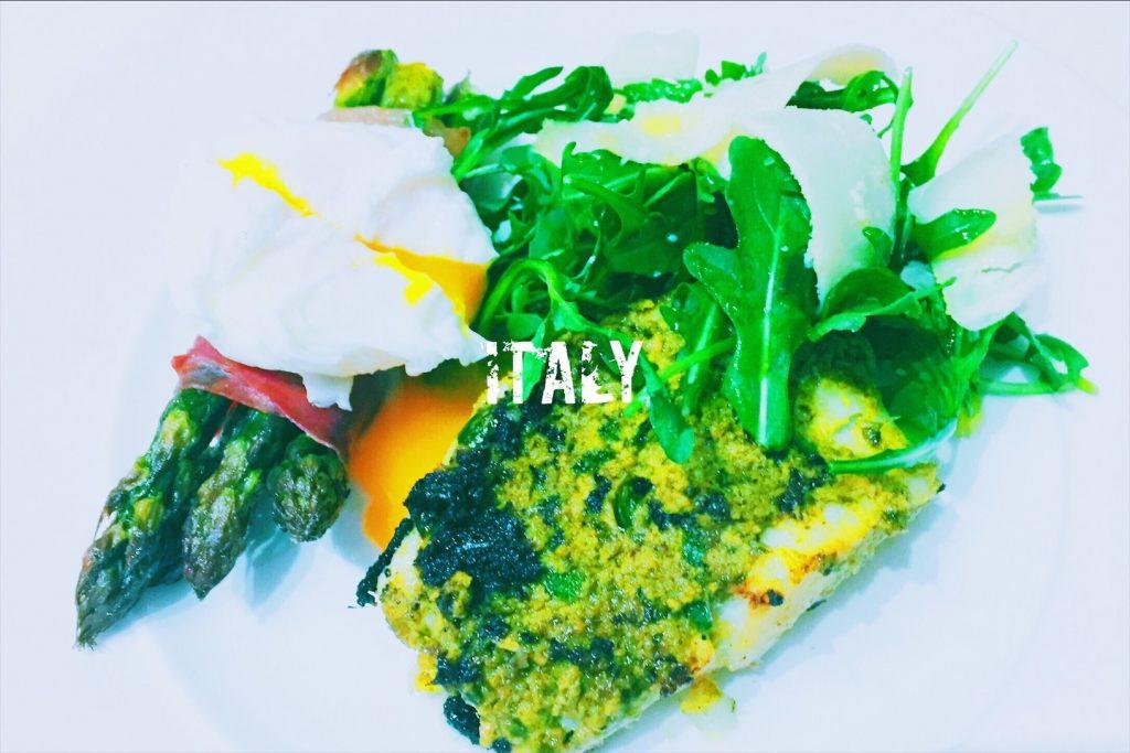 Italian pesto cod with asparagus in Parma ham national dish Italy