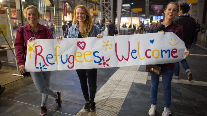 german girls welcome refugees