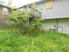 Overgrown grass at a Deutsche Bank-owned house in Capitol Heights, MD (Predominantly African American)