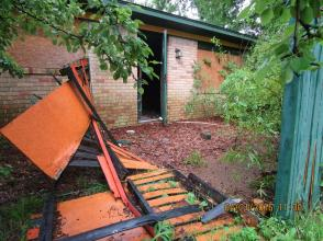 An open door and piles of trash were found at this Deutsche Bank property in a non-White neighborhoods in Memphis.