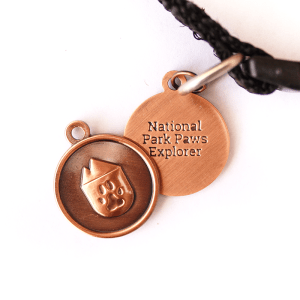 national park paws dog tag, light weight water proof in antique copper