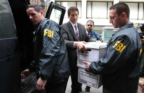 FBI Agents Load Seized Documents From the National Report's Offices