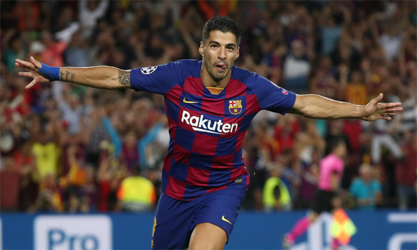 Atletico signs Suarez from Barcelona