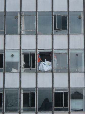 JA BALL Abbey Street builder throw rubish out of window