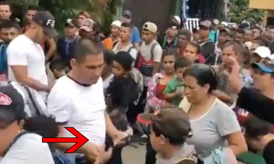 Video: Someone Is Handing Out Stacks Of Cash To The Migrants Headed To The United States
