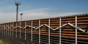 Mexico–United States barrier at the border of Tijuana, Mexico and San Diego, USA. The crosses represent migrants who died in the crossing attempt. Some identified, some not. Surveillance tower in the background.