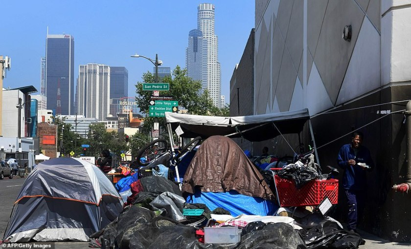 Belongings of the homeless crowd a downtown Los Angeles sidewalk in Skid Row. The city of Los Angeles on May 29 agreed to allow homeless people there to keep their property and not have it seized, providing the items are not bulky or hazardous