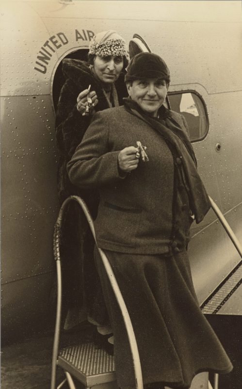 Gertrude Stein and her partner Alice Toklas exit a plane in Chicago in 1934