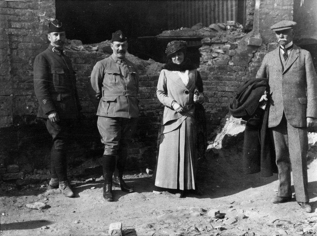 Edith Wharton, her friend Walter Berry, and two soldiers pose in France during World War I
