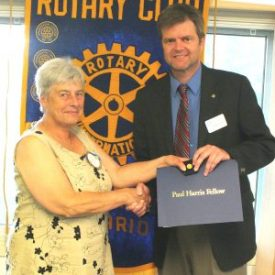 Elka Brown receives her Paul Harris pin and certificate from outgoing president Nelson Zandbergen.