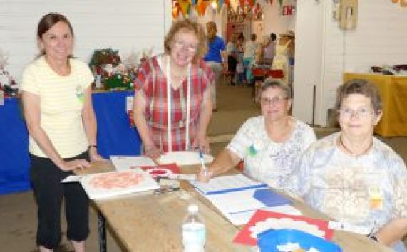 From left at the hobbies- and craft-judging table, Debbie Whyte, Rita Penner, Andrea Desormeaux and Lois Beckstead. Zandbergen photo, Nation Valley News