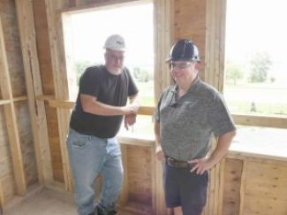 Long Sault Villa owner Henri Lecours (right) and Tal-Co Building Innovations Site Supervisor Mark Reoch, who's with the company handling the expansion and renovations at the establishment. Zandbergen photo, Nation Valley News