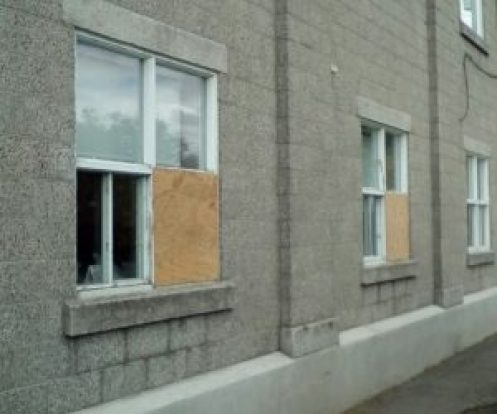Boards now cover the damaged window openings. Nation Valley News