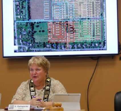 South Dundas Mayor Evonne Delegarde enthuses about the proposed Dutch Meadows subdivision, with an image of the planned development on the big screen behind her. Zandbergen photo, Nation Valley News