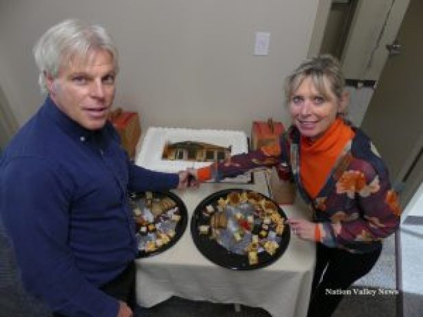 Spouses Dr. George Carlin and Sandra Carlin cut the cake at the official opening. Zandbergen photo, Nation Valley News