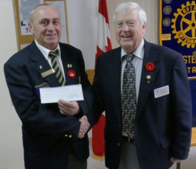 Chesterville Rotary Club President Joe Cass presents $400 from the Club to the Chesterville Legion, Nov. 7. Peter Elliott receives the donation on behalf of Legion Branch 434. Zandbergen photo, Nation Valley News