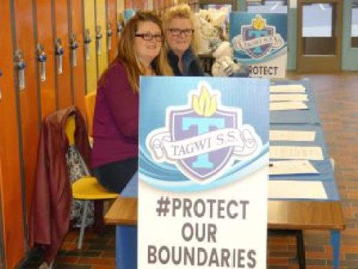"Members of Tagwi: Protect Our Boundaries collected signatures on MPP Jim McDonell's petition opposing the Upper Canada District School Board's ""Building for the Future"" Accommodation Review process, Saturday, Dec. 3 at the school. Joanne Haley (foreground) and Lianne Acres-Hanna collected over 100 names by day's end, and also helped about 50 people fill out the Upper Canada District School Board's ongoing survey. And they sold out of 'Protect Our Boundaries' signs. A new batch will be available this week, according to Haley. Zandbergen photo, Nation Valley News"