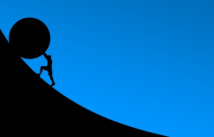 Man pushing ball up a hill, representing native advertising challenges