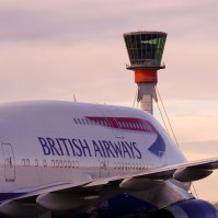 A BA 747 in front of the Heathrow Airport tower
