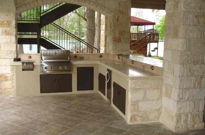 an outdoor balcony kitchen
