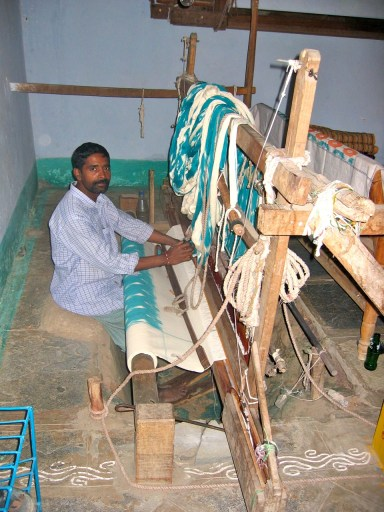 Hand loom weaver in a pit loom