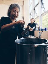 Yoshiko stirring the vat in a forceful circular motion. Photo Courtesy: Anu Ravi