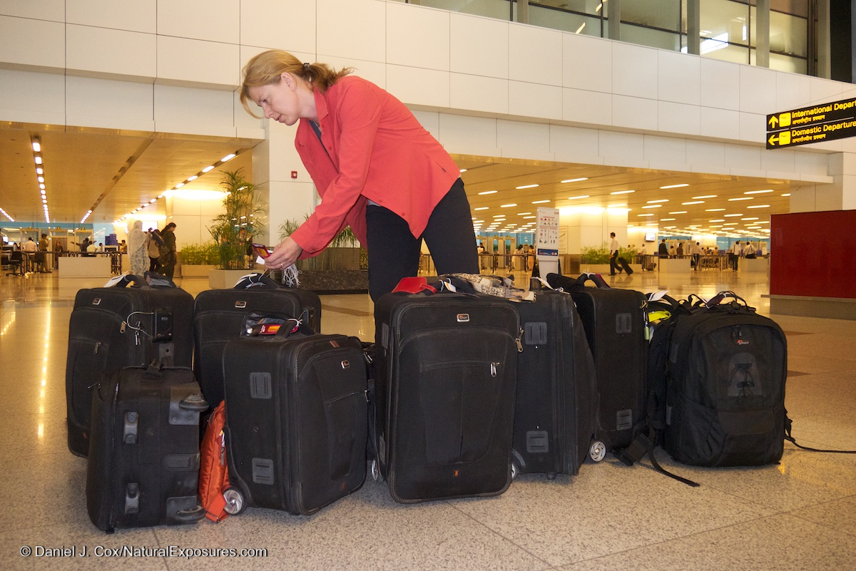 Tanya attaches security tags to the many Lowepro camera bags that our group was traveling with in India