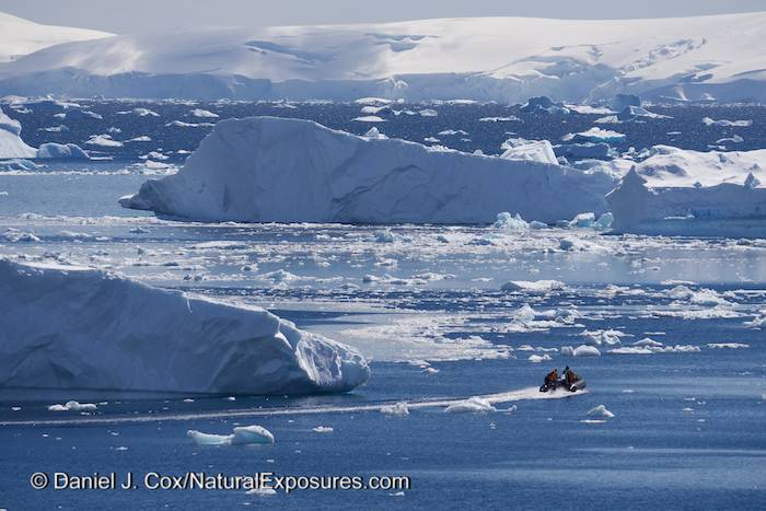 Zodiac going back to the Seabourn ship through ice. Cuverville Island. Antarctica. Lumix GH3.
