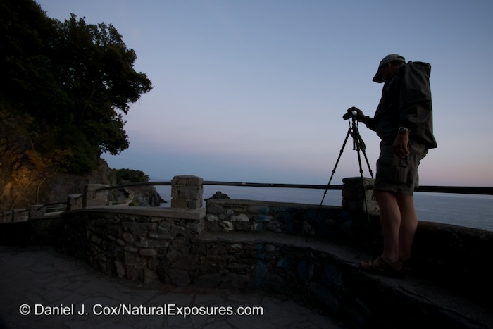 Dan shooting the blue light of dusk along the cliffs of Monterosso, Italy