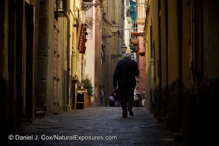 An older Italian gentleman walks the narrow streets of Sorrento, Italy