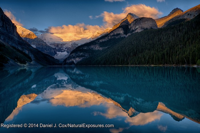 Lake Louise reflects the alpenglow on surrounding mountains of Mt Victoria and Mt Lefroy. Banff National Park, Alberta. Lumix GH4 with 12-35mm. HDR