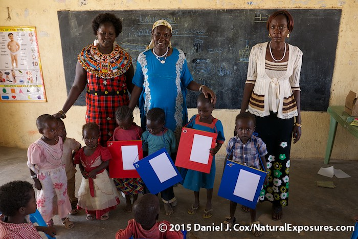 Rose Lisamba with her two teaching colleagues and several children from their Samburu village school. Kenya