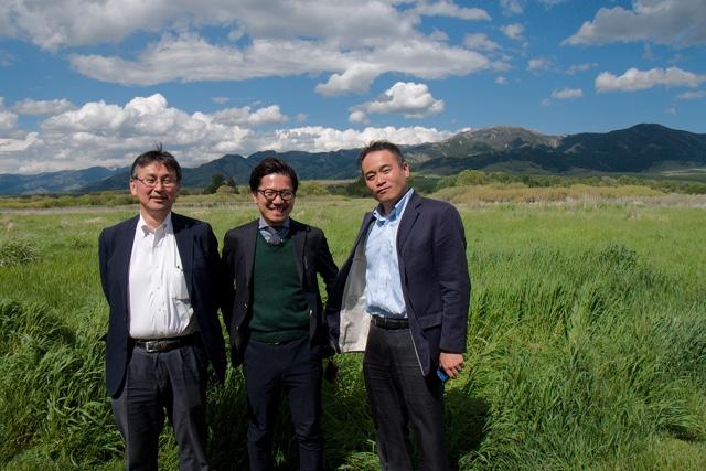 Henri Nishikawa, Shinji Watanabe and Yasuhide Yamada get their picture taken in front of the beautiful Bridger Mountains outside of Bozeman, Montana