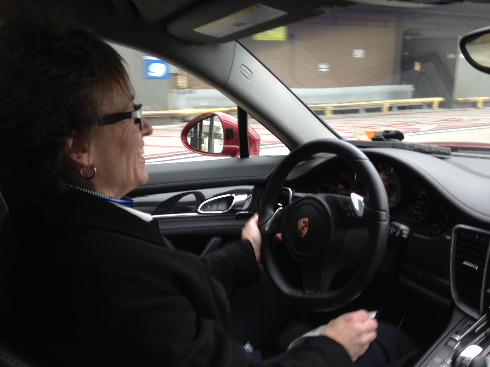 Delta employee extraordinaire Deborah Pratt behind the wheel of a fabulously gorgeous Porsche driving me to my gate so I don't miss my flight to Bozeman.