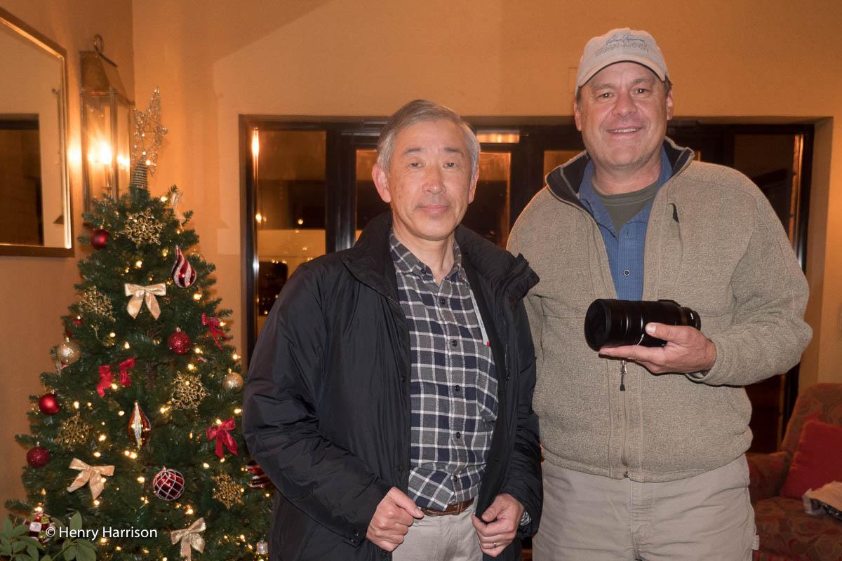 Panasonic Chief engineer Takanori Yabuki hands Daniel Cox the new 100-400mm zoom lens Panasonic developed for a shoot in Bosque Del Apache, New Mexico.