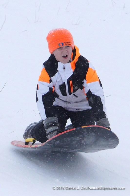 Isabella and Isak sledding on Pete's Hill. Bozeman, Montana