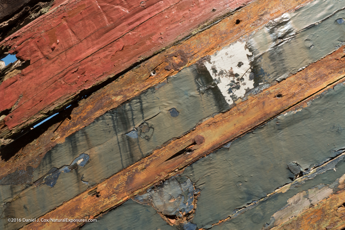 Fading colors on the hull of a depleted old boat in the Isle of Skye in Scotland. Lumix GX8 ISO 200