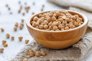 Bowl of chickpeas so full that some are overflowing